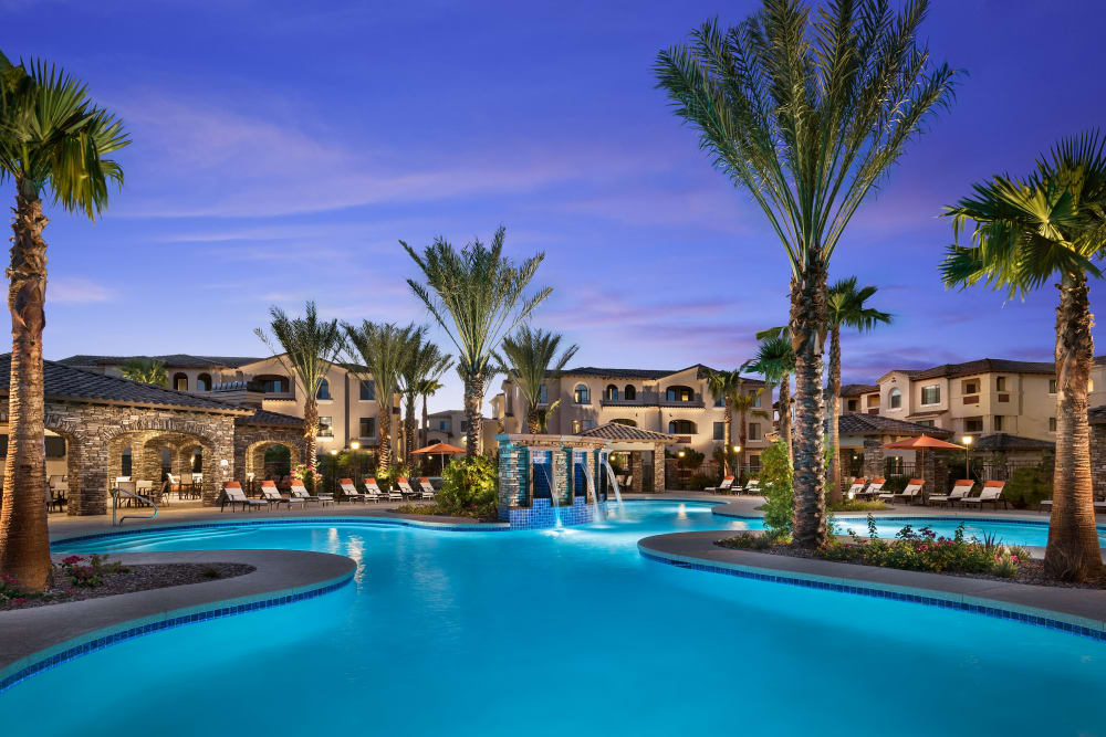 Resort-style swimming pool with sundeck and lounge chairs at San Posada in Mesa, Arizona