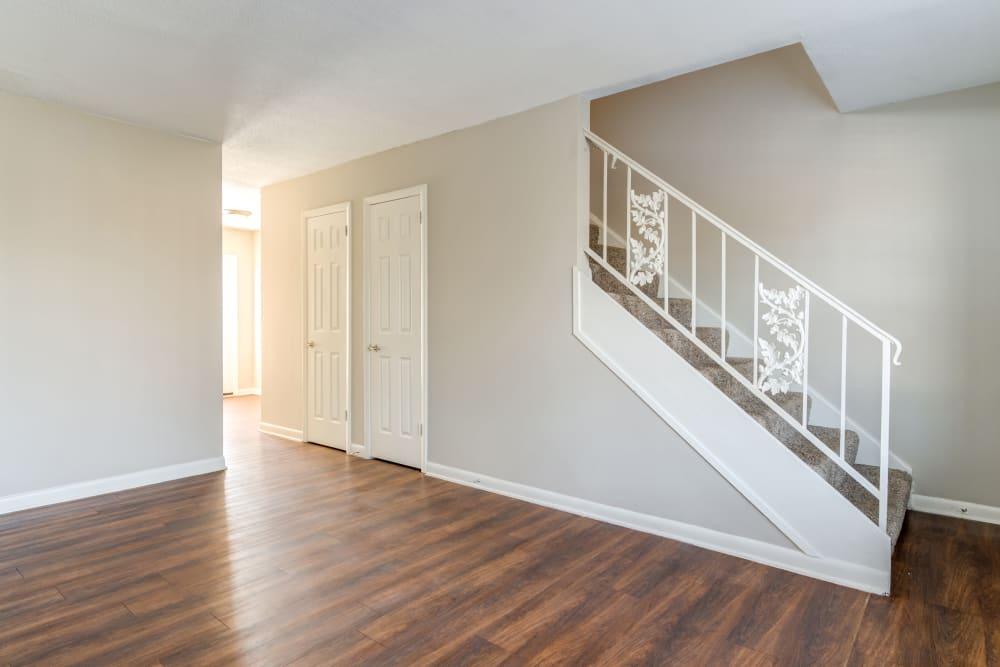 Open living area with hardwood floors at Audubon Park in Nashville, Tennessee