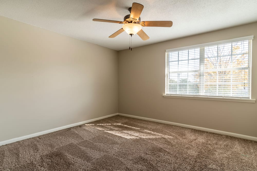 Audubon Park offers a cozy bedroom with ceiling fan in Nashville, Tennessee