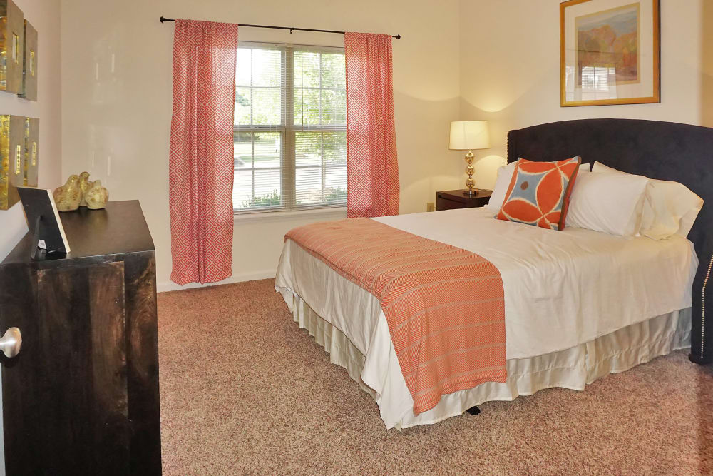 Cozy bedroom with drapes in model home at Valley Farms in Louisville, Kentucky