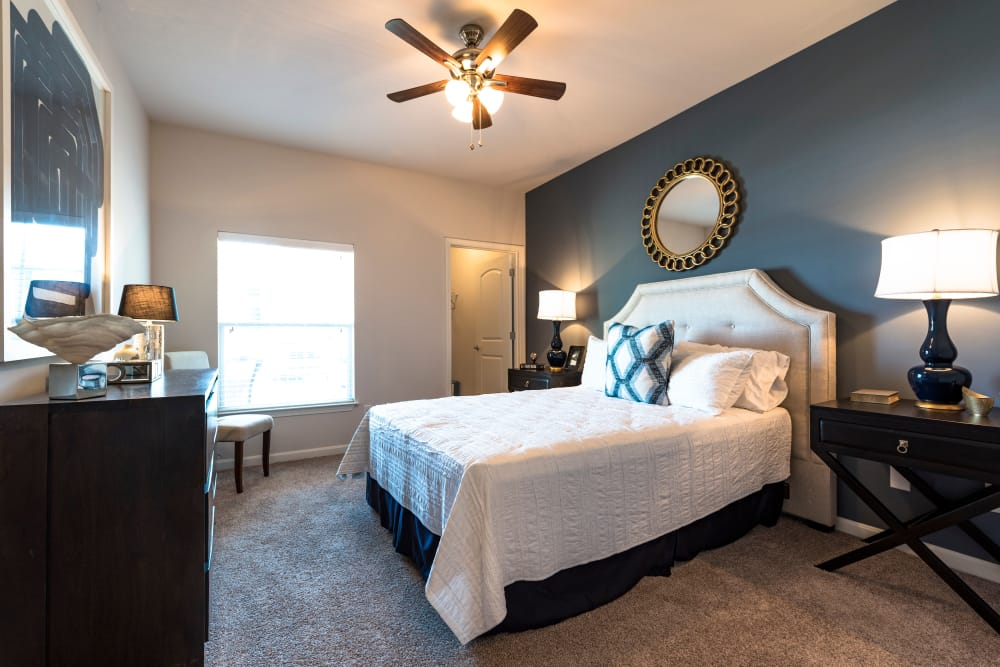 Spacious master bedroom with ceiling fan in model home at Valley Farms in Louisville, Kentucky