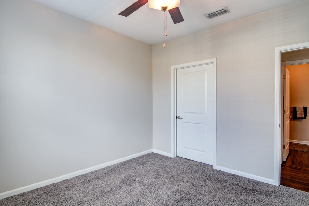 Bedroom with ceiling fan at Cantare at Indian Lake Village in Hendersonville, Tennessee