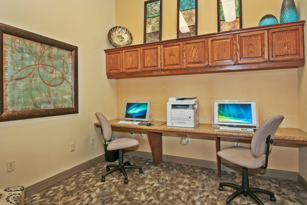 Business center with computers for resident use at The Landing at Mansfield in Mansfield, Texas