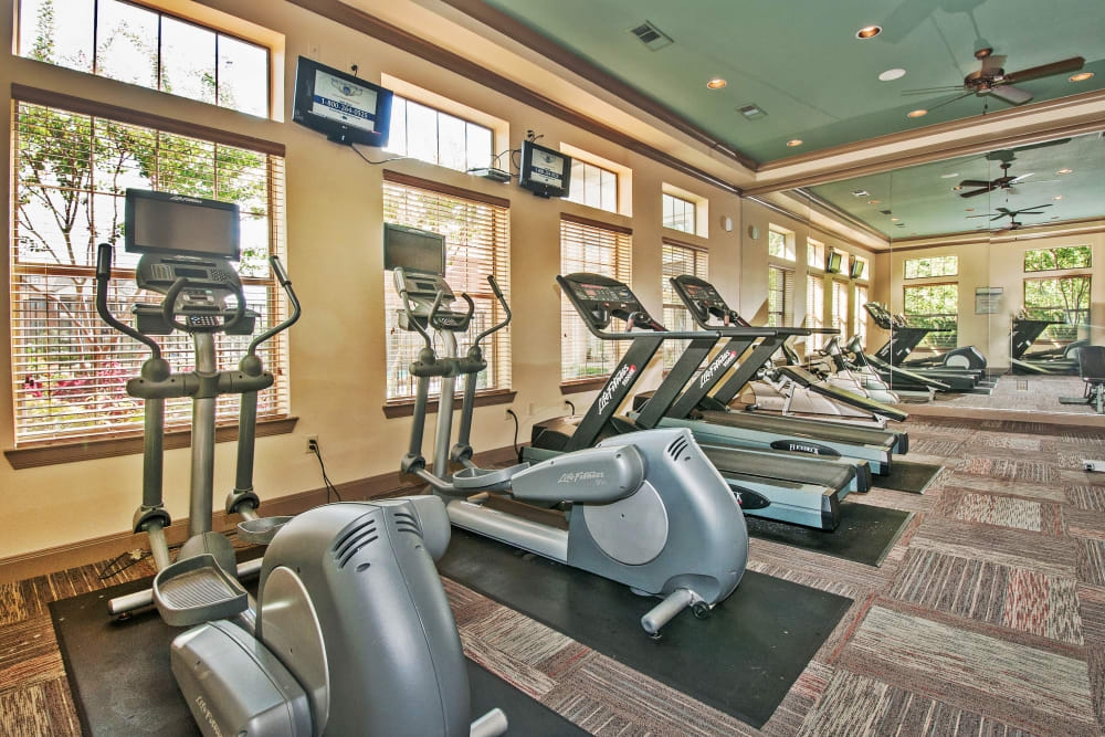 Well-equipped fitness center at The Landing at Mansfield in Mansfield, Texas