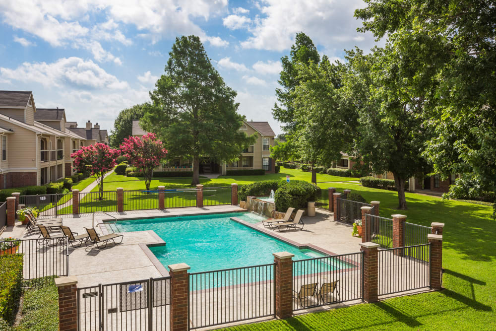 Swimming pool on a beautiful sunny day at The Arbors of Carrollton in Carrollton, Texas