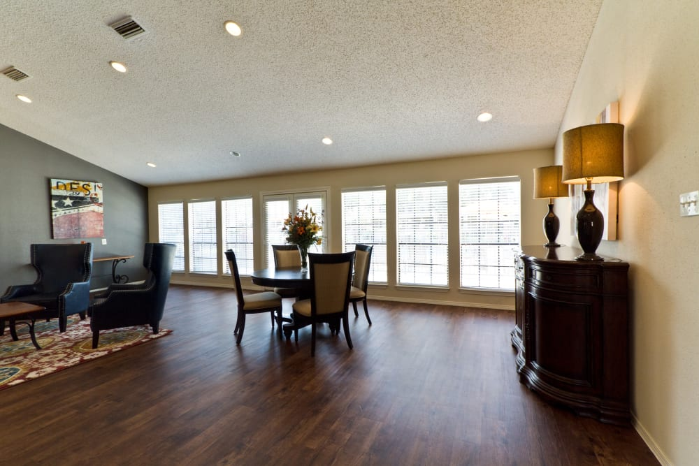 Hardwood floors and areas to chat with your friends and neighbors at The Arbors of Carrollton in Carrollton, Texas
