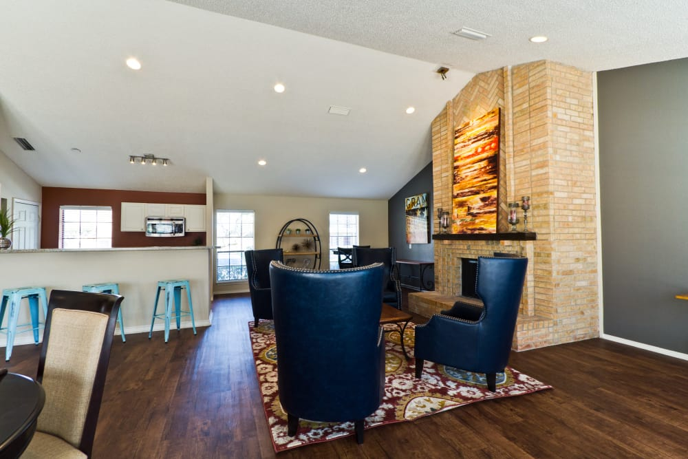 Bright and spacious living area at The Arbors of Carrollton in Carrollton, Texas