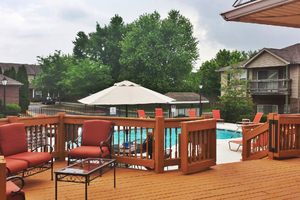 Deck with comfortable seating areas near the pool at Cooper Creek in Louisville, Kentucky