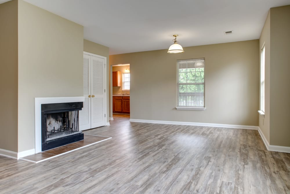 Enjoy a modern living room with fireplace at Cooper Creek in Louisville, Kentucky