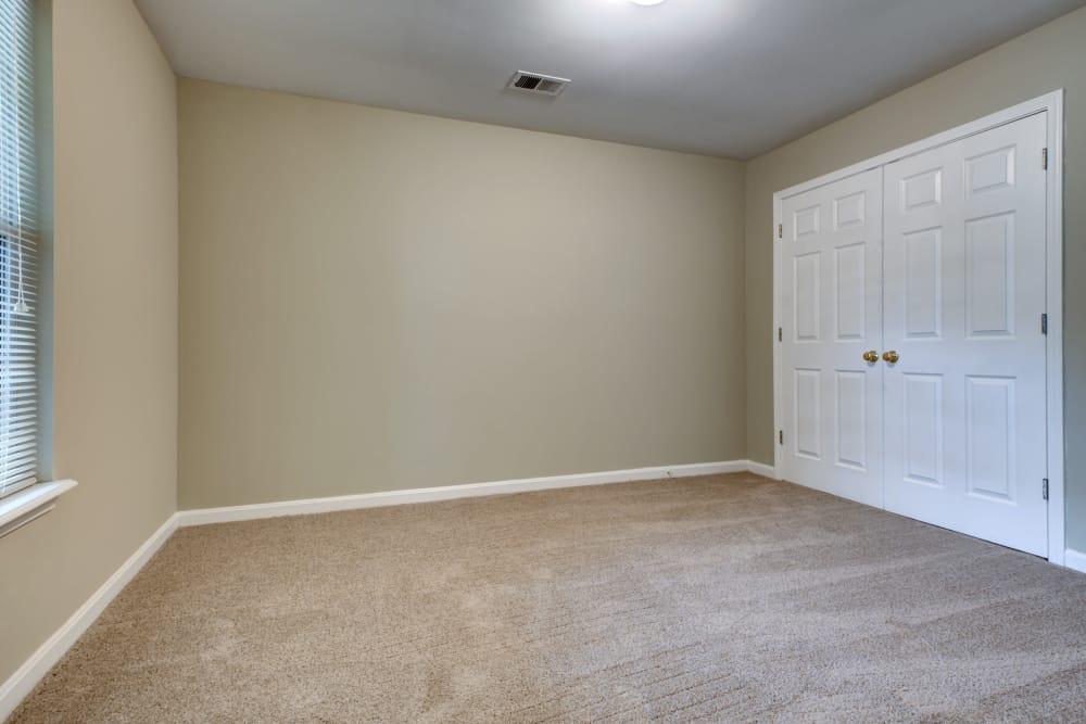 Bedroom with closet at Cooper Creek in Louisville, Kentucky