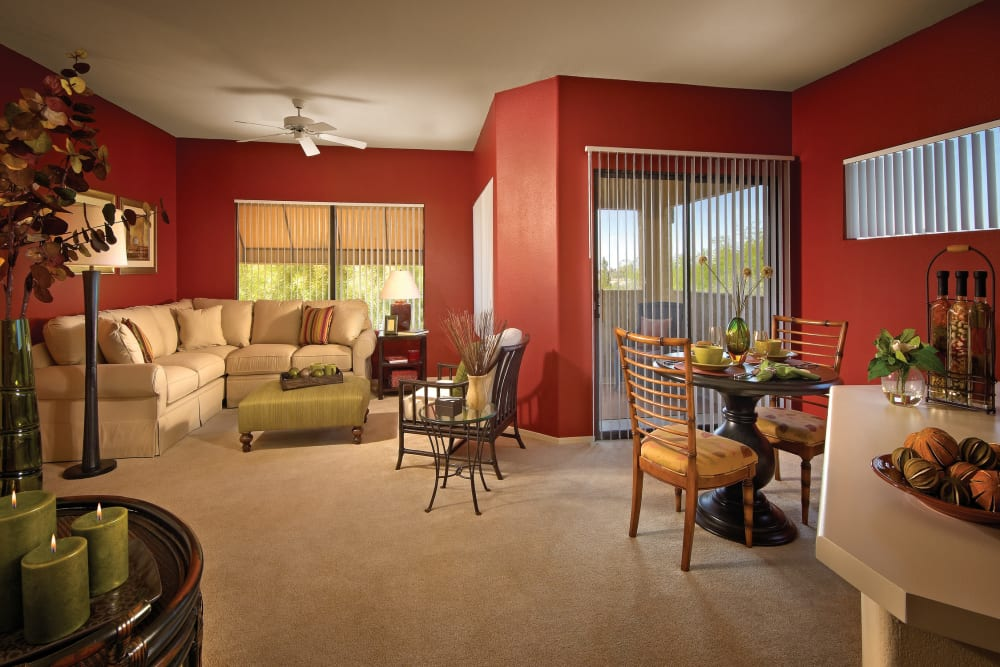 Beautiful open-concept floor plan with plush carpeting in model home at Waterside at Ocotillo in Chandler, Arizona