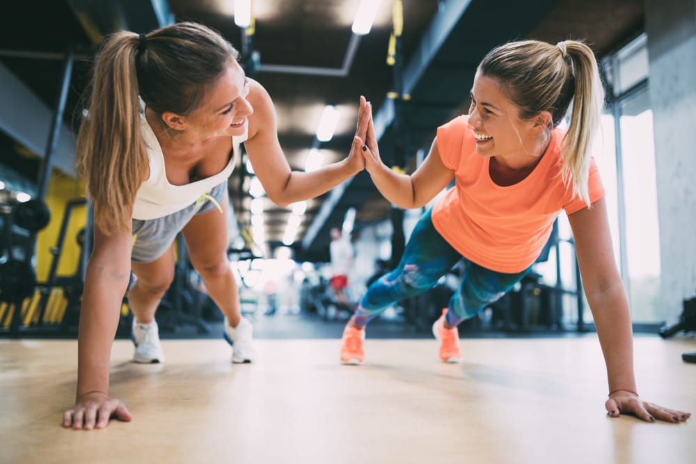 Residents working out in the fitness center at The Local Apartments in Tempe, Arizona