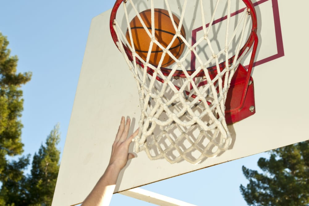 Resident playing basketball at Pine Tree Apartments in Chico, California