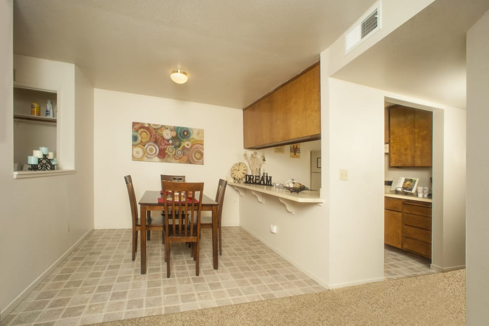 Dining room next to the kitchen at Pine Tree Apartments in Chico, California