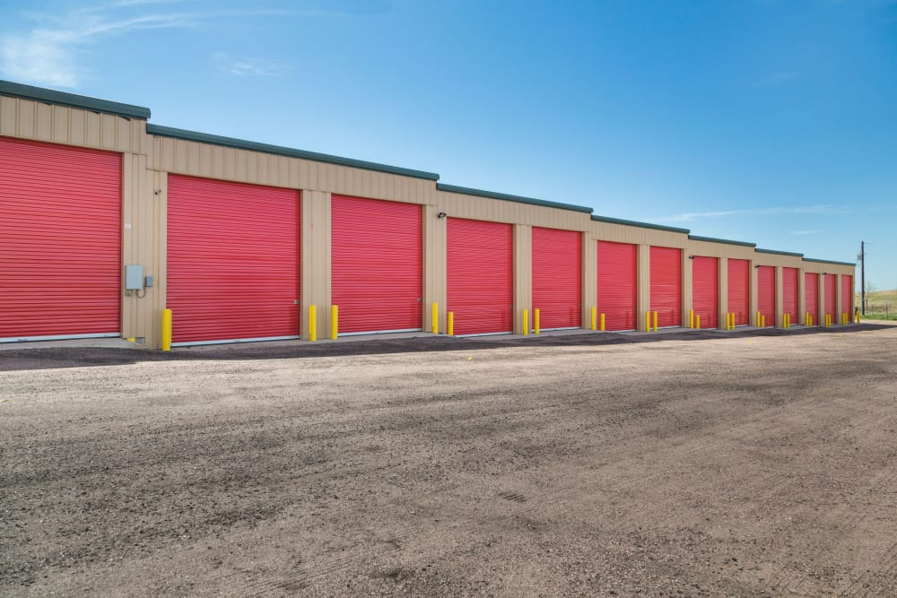 Red roll-up doors at Smart Space Self Storage - Stetson Hills in Colorado Springs, Colorado