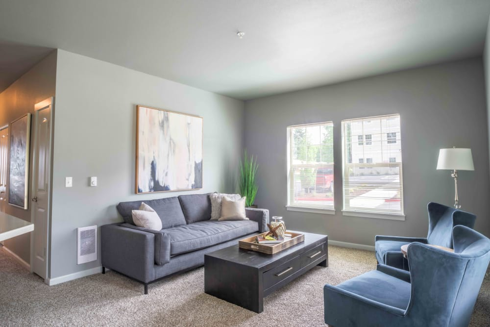 Bright living room at River Ridge Apartments in Tualatin, Oregon