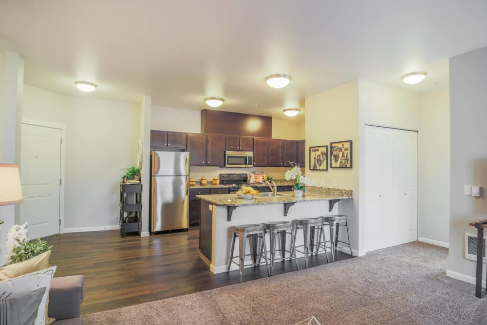 Kitchen with bar style seating at Keizer Station Apartments in Keizer, Oregon