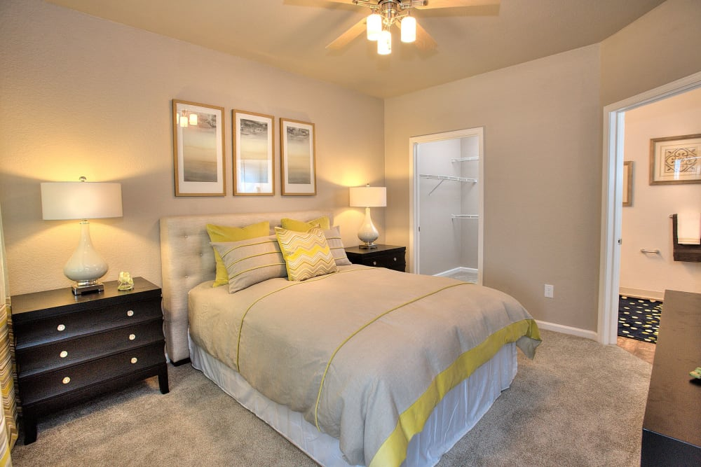 Enjoy a cozy bedroom at Centro Apartment Homes home in Hillsboro, Oregon