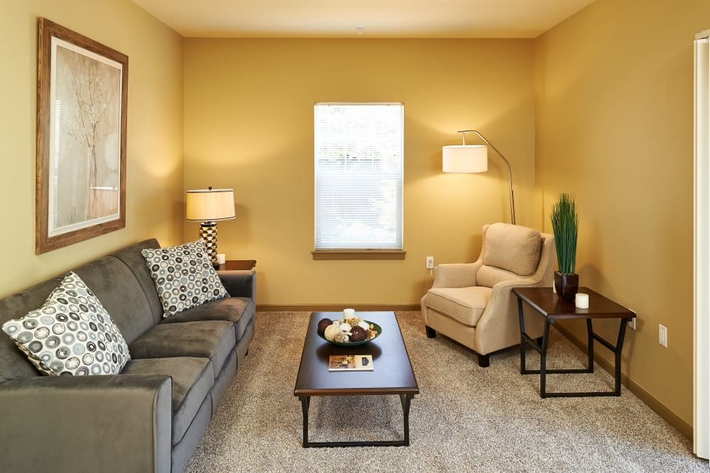 Bright living room at Heritage Meadow Apartments in Eugene, Oregon