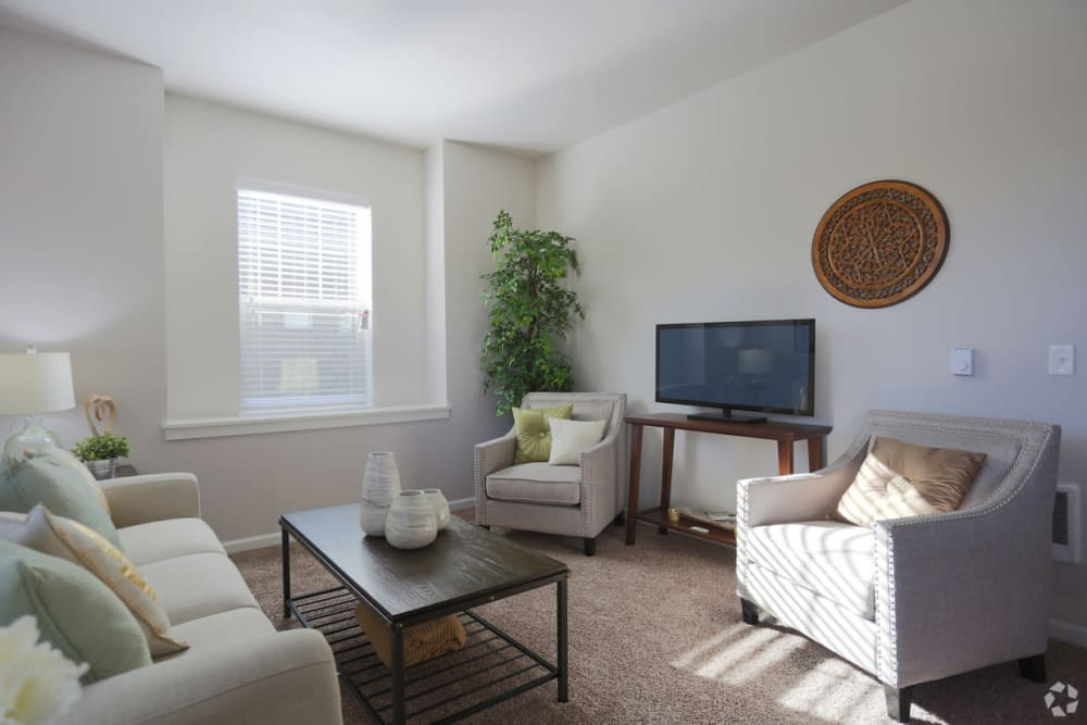 Bright living room at The Fairway Apartments in Salem, Oregon