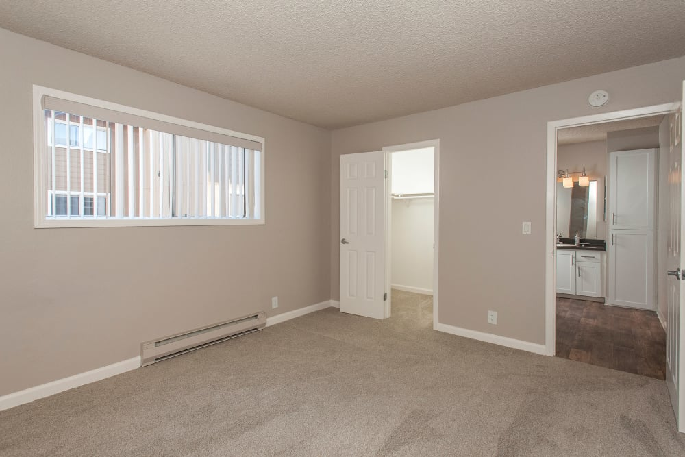Enjoy a cozy bedroom with ensuite bathroom at Shadow Oaks Apartment Homes in Cupertino, California