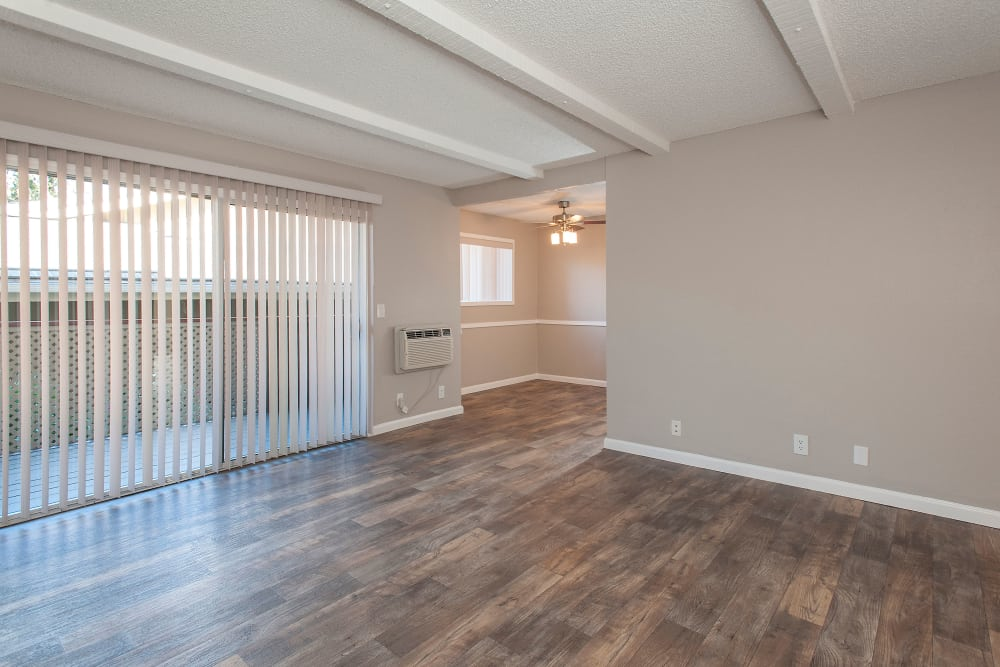 Living room with hardwood flooring at Shadow Oaks Apartment Homes homes in Cupertino, California