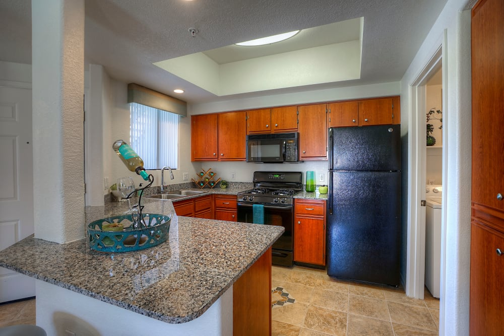 Granite countertop and custom cabinetry in kitchen at San Palacio in Chandler, Arizona