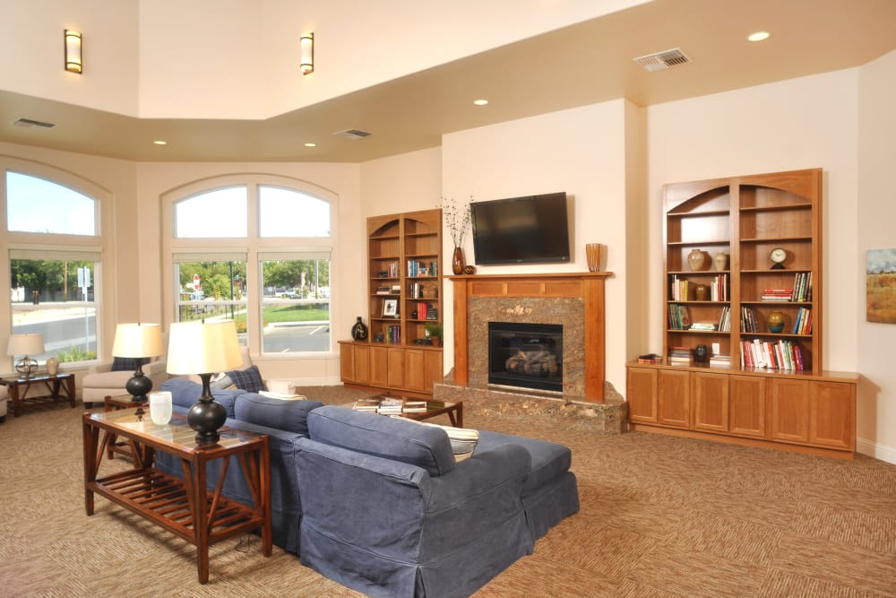 Clubhouse with a fireplace and ample seating at Villa Risa Apartments in Chico, California