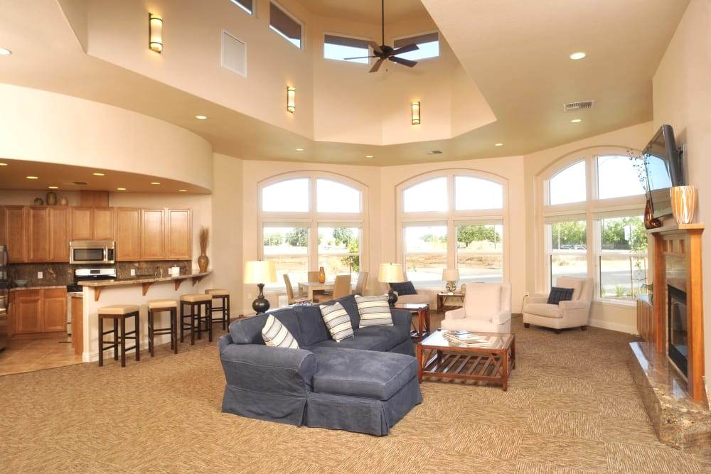 Spacious clubhouse with kitchen and bar seating at Villa Risa Apartments in Chico, California