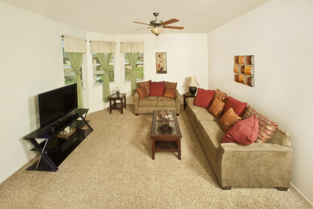 Living room with ceiling fan at Villa Risa Apartments in Chico, California
