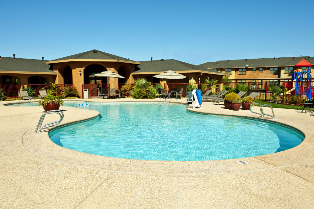 Resort style swimming pool on a beautiful sunny day at Villa Risa Apartments in Chico, California