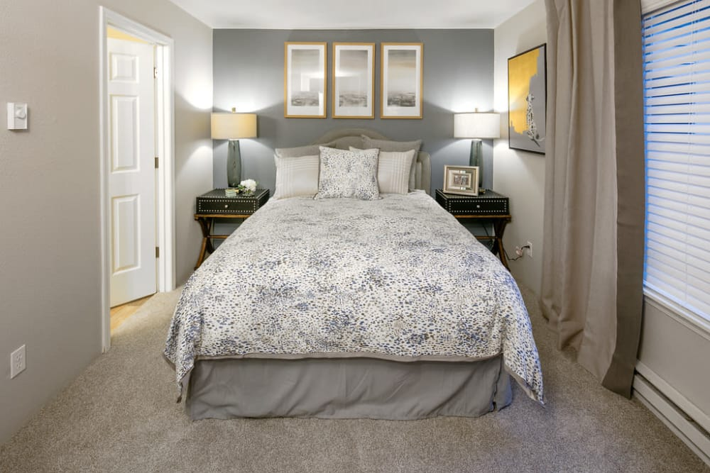 Well decorated model bedroom at Waterhouse Place in Beaverton, Oregon
