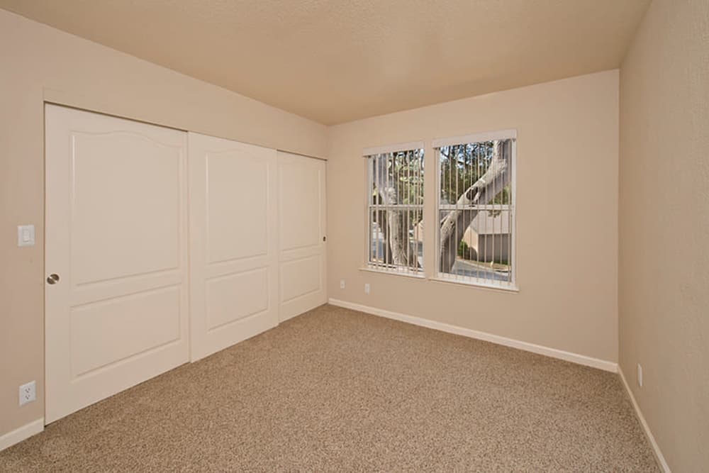Spacious room with closet at Seventeen Mile Drive Village Apartment Homes in Pacific Grove, California