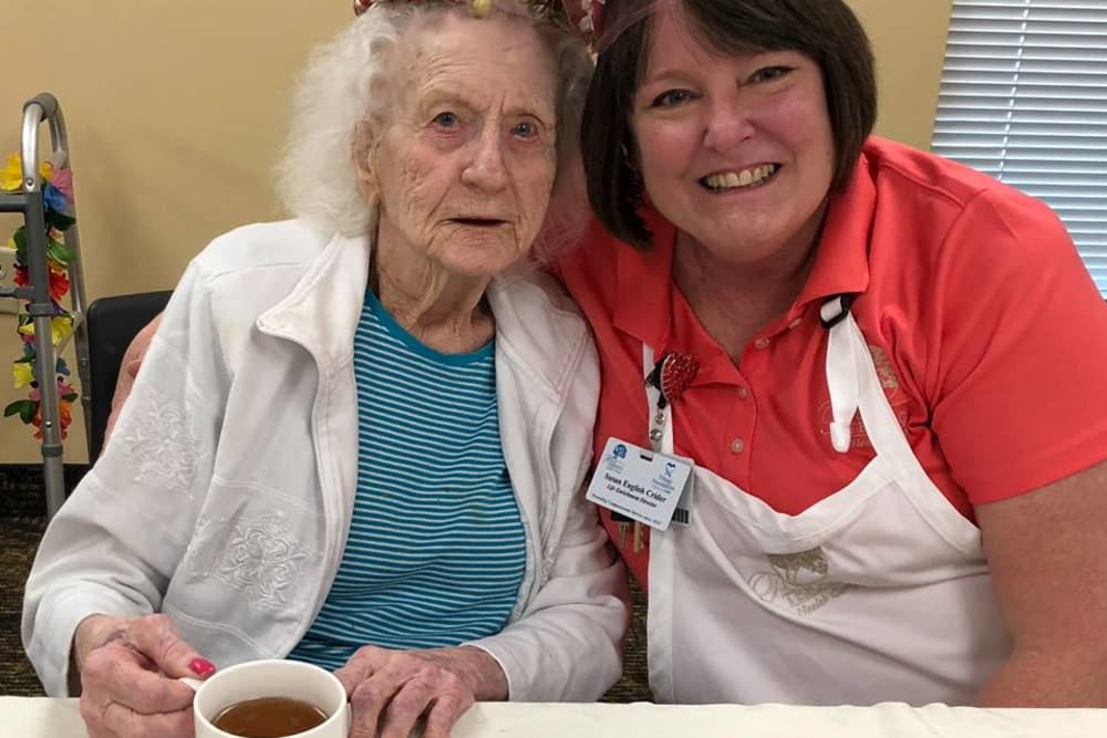 A resident and caretaker with floral crowns at Park Terrace Health Campus in Louisville, Kentucky