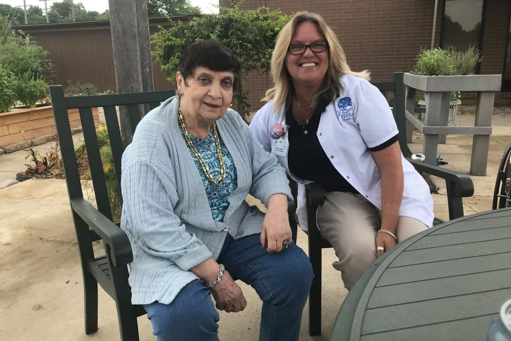 A resident and care taker sitting outside at Park Terrace Health Campus in Louisville, Kentucky