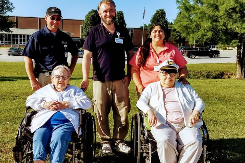 Residents with caretakers enjoying the outdoors at Owen Valley Health Campus in Spencer, Indiana