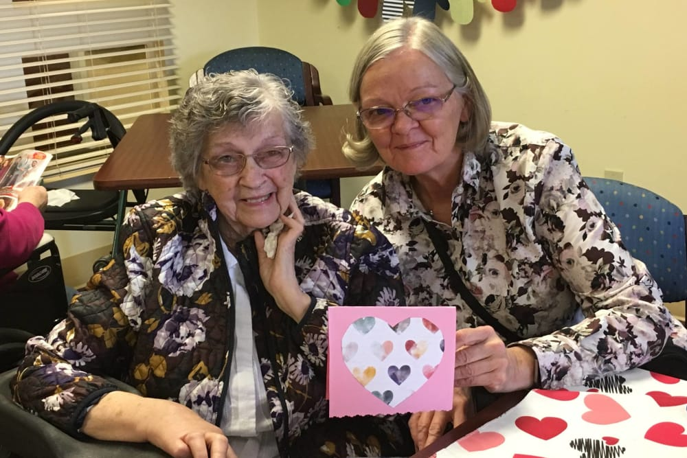Two residents showing their artwork at RidgeCrest Health Campus in Jackson, Michigan