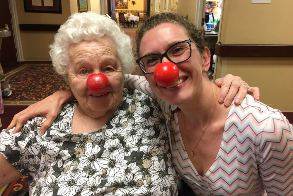 A resident and caretaker with red noses on at RidgeCrest Health Campus in Jackson, Michigan