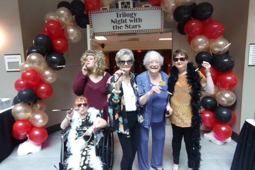 Residents posing with props at Glen Oaks Health Campus in New Castle, Indiana