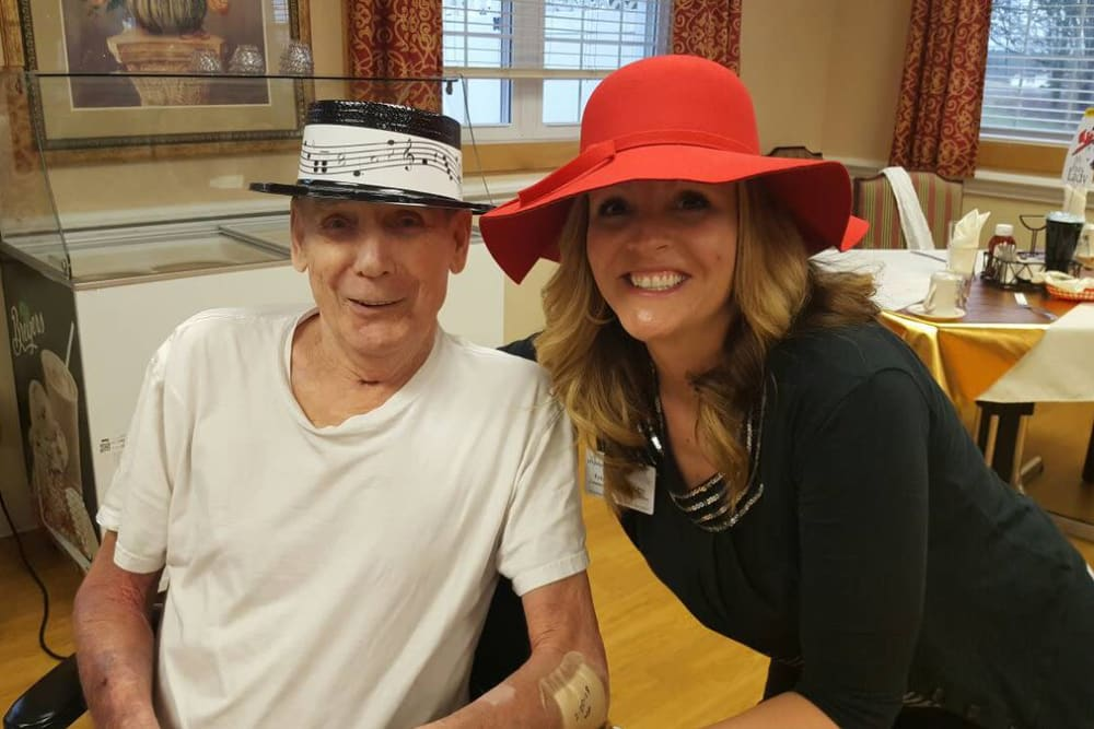 A resident and caretaker with hats on at Highland Oaks Health Center in McConnelsville, Ohio