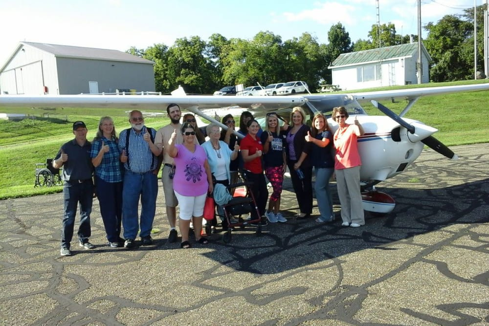 Residents from Highland Oaks Health Center in McConnelsville, Ohio next to a plane