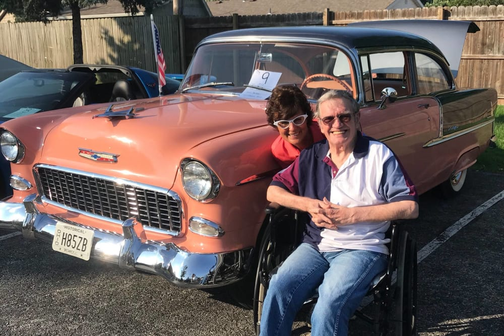 Two residents from The Heritage in Findlay, Ohio at a classic car show