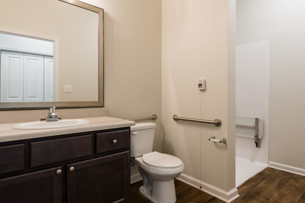Restroom with a stand up shower at The Mansions at Alpharetta Assisted Living and Memory Care in Alpharetta, Georgia