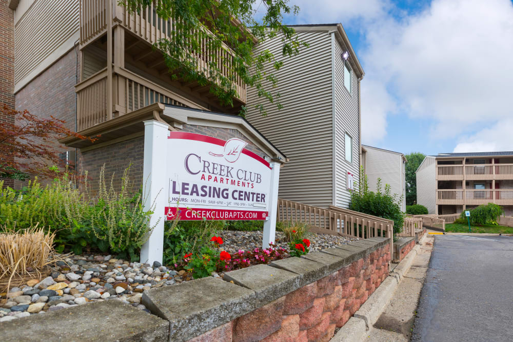 Sign at Creek Club Apartments' leasing center in Williamston, Michigan