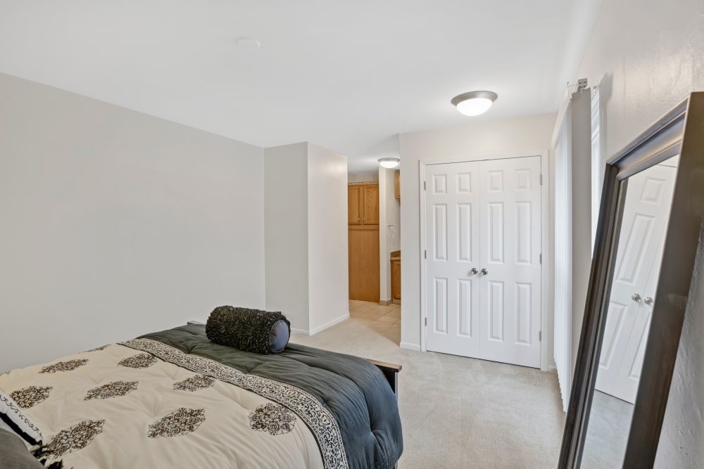 Bedroom at Creek Club Apartments in Williamston, Michigan