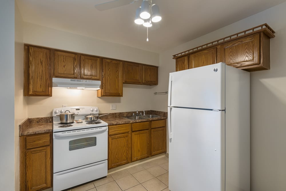 Fully equipped kitchen at Creek Club Apartments in Williamston, Michigan