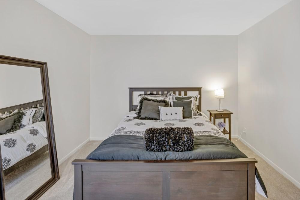 Bright bedroom at Creek Club Apartments in Williamston, Michigan