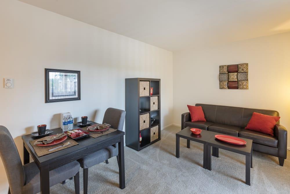 Bright living room at Creek Club Apartments in Williamston, Michigan