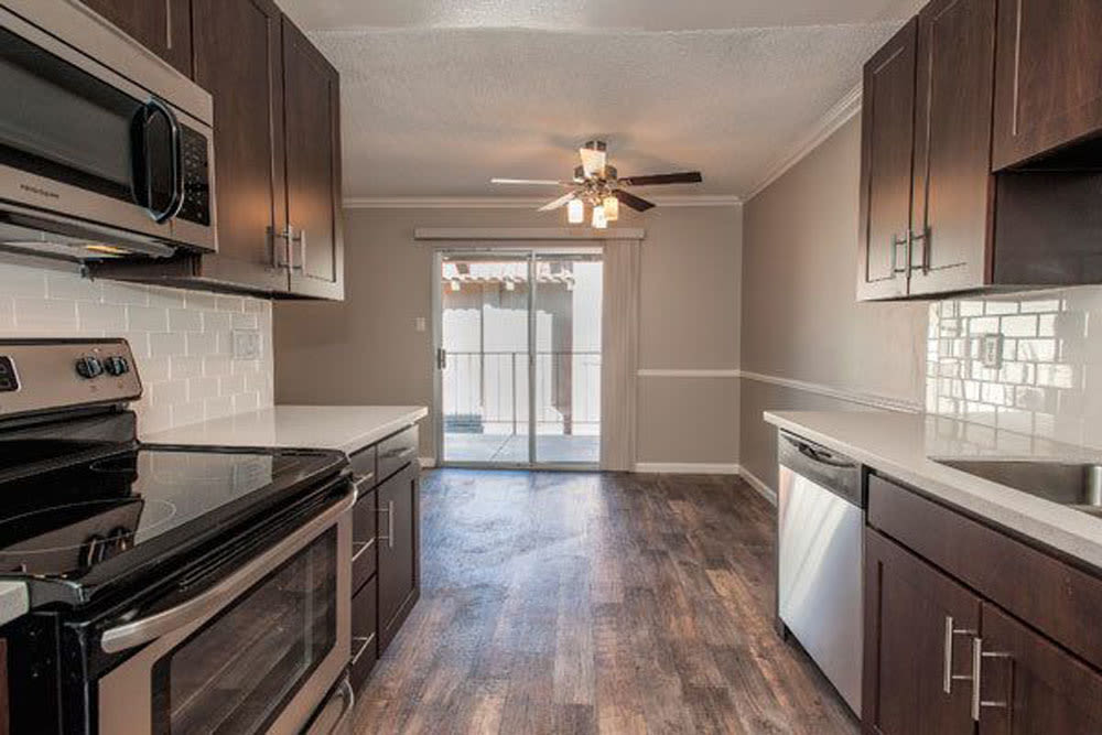 Kitchen with stainless-steel appliances at La Valencia Apartment Homes in Campbell, California