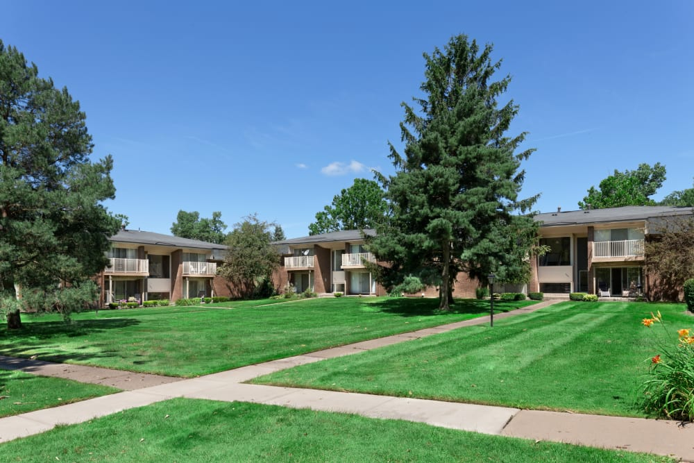 Pathways among well-manicured lawns at Kensington Manor Apartments in Farmington, Michigan